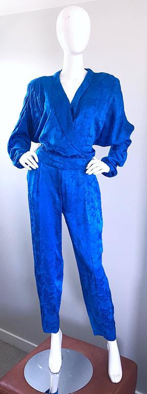 Amazing vintage FLORA KUNG royal blue silk jumpsuit! Buttons up the bodice, with interior buttons to keep everything in place. Snap at bust can be snapped shut or left open for a little extra cleavage. Zipper fly. Chic dolm,an sleeves can accomodate