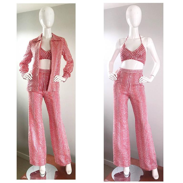 Rare 1970s ANTHONY MUTO for LILLIE RUBIN red and white gingham sequined three piece set! Features a cropped bra top, high waisted wide leg trousers, and a collared blouse. Thousands of hand-sewn clear iridescent sequins on a nice cotton throughout.