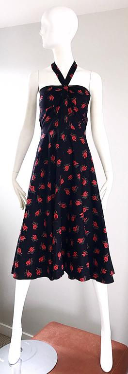 Smashing vintage GUY LAROCHE Oriental themed cotton halter sun dress! Features a black body, with an amazing red fan-like print throughout. Flattering fitted bodice, with a nice forgiving full skirt. Halter style ties at the back neck. Hidden zipper