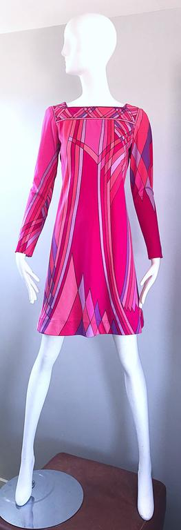 Amazing vintage 60s NAT CAPLAN COUTURE long sleeve A-Line / shift dress! Features a shocking hot pink background with geometric mosaic print in fuchsia, lavender and purple. Tailored bodice with a nice flared skirt. Long tailored sleeves. Jersey