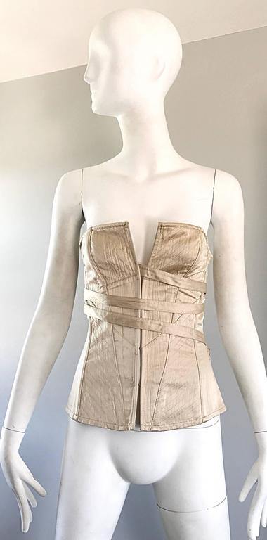 Brand new with tags late 1990s LA PERLA champagne / khaki silk bustier/corset top! Features an attached ribbon that laces through slots on each side. Interior boning keeps everything in place. Hook-and-eye closures up the front. Can easily be
