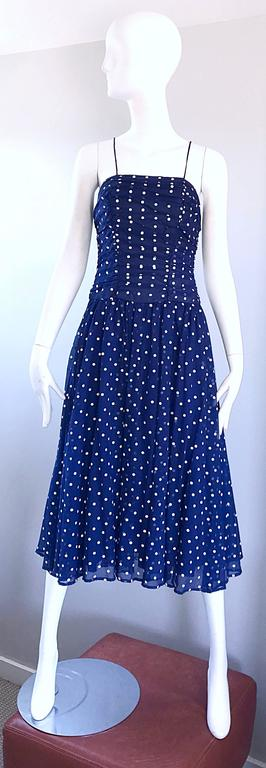 Chic vintage navy blue and white hand painted flirty spaghetti strap midi dress! Features a flattering ruched bodice and a forgiving full skirt. Layers of the skirt give the perfect flowy effect when worn. Fantastic quality with no designer labels