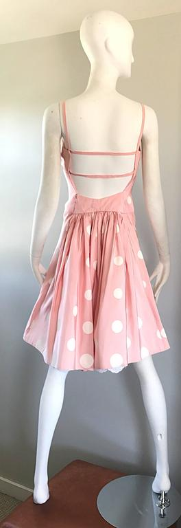 Chic 90s BILL BLASS pale pink and white hand painted polka dot fit n' flare cocktail silk taffeta dress! Features large handpainted polka dots throughout. Attached white lace underlay peeks through at the back hem. Peek-a-boo back with a center