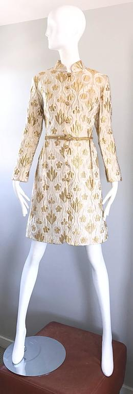 Chic 1960s VICTOR COSTA Romantica for Lord and Taylor gold and ivory metallic silk brocade long sleeve dress! Features a detachable gold cord belt, with 10 gold embroidered buttons up the front, with hook-and-eye closure at the waist. Pocket at each