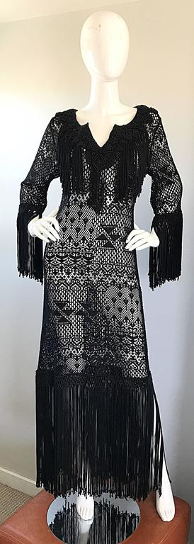 Amazing 1970s hand crochet black open weave fringed couture quality  maxi dress! Incredible amount of details that were completely sewn by hand. Fringe detail at collar, sleeves, and hem. Embrodiered details also at collar and hem (directly above