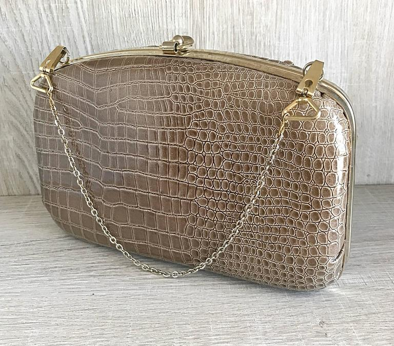 Chic 1940s Italian made alligator / crocodile embossed patent leather bag! Perfect taupe color is great all year, and matches anything. Pale gold hardware, and removable chain strap. Clasp securely shuts the bag. Chain is removable, and can be worn