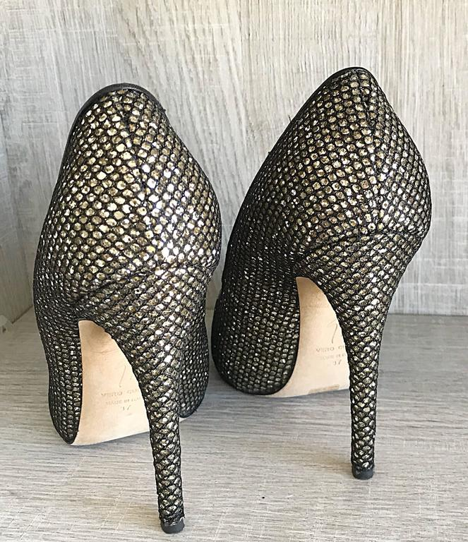 Beautiful GIUSEPPE ZANOTTI black and silver glitter peeptoe heels! Only worn once for a phot shoot, and in perfect condition. Features a hidden platform for extra comfort. A great alternative to a classic black heel. Great with jeans, a dress, or
