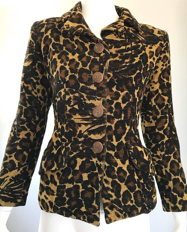 Iconic, and nothing short of spectacular early 1990s YVES SAINT LAURENT YSL ' Rive Gauche ' leopard cheetah print tailored jacket! Four large wood buttons up the front. Pockets at each side of the waist. Fully lined. Incredibly well made. Can easily