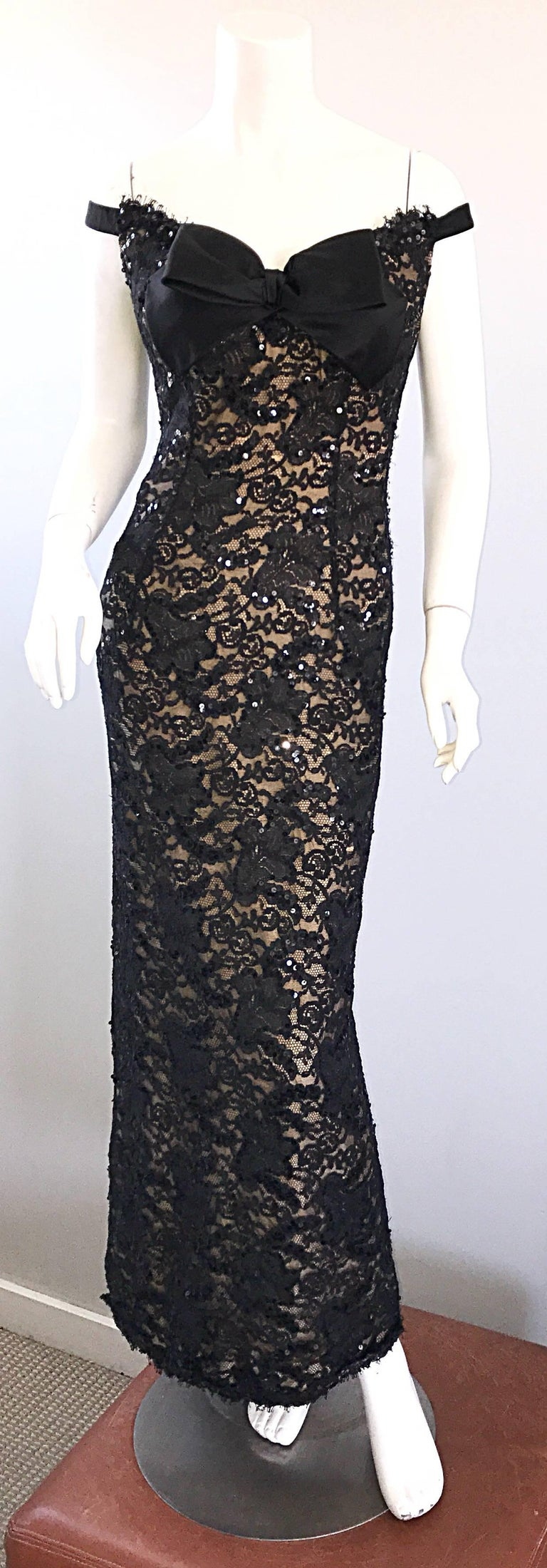 Gorgeous vintage 1990s BOB MACKIE black and nude lace and sequined evening dress! Features a flattering off-the-shoulder silhouette, and a slight train. Nude underlay peaks under the black lace. Thousands of hand-sewn sequins throughout. Black silk