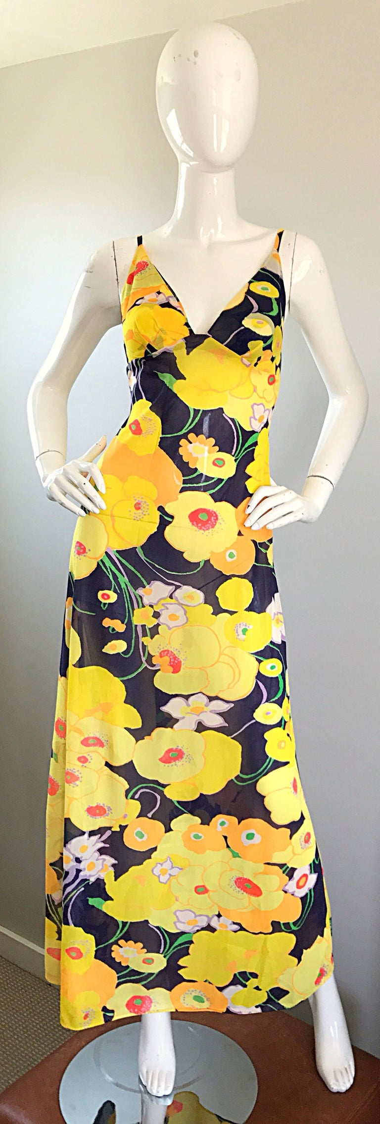 Amazing 1970s CHRISTIAN DIOR / MISS DIOR vibrant colored flower maxi dress and jacket! Features brightly colored flower prints in yellow, navy blue, red, white, lavender purple, green and orange throughout. Maxi dress features a fitted bodice with a