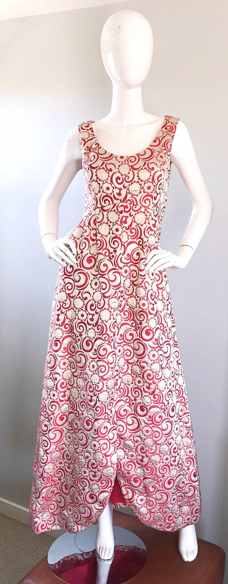 Spectacular 1960s CEIL CHAPMAN gold metallic and raspberry pink silk brocade flowers and swirls printed full length evening dress! Features pink flowers and swirls throughout. Elegant tulip hem creates a dramatic affect when worn. POCKETS at each