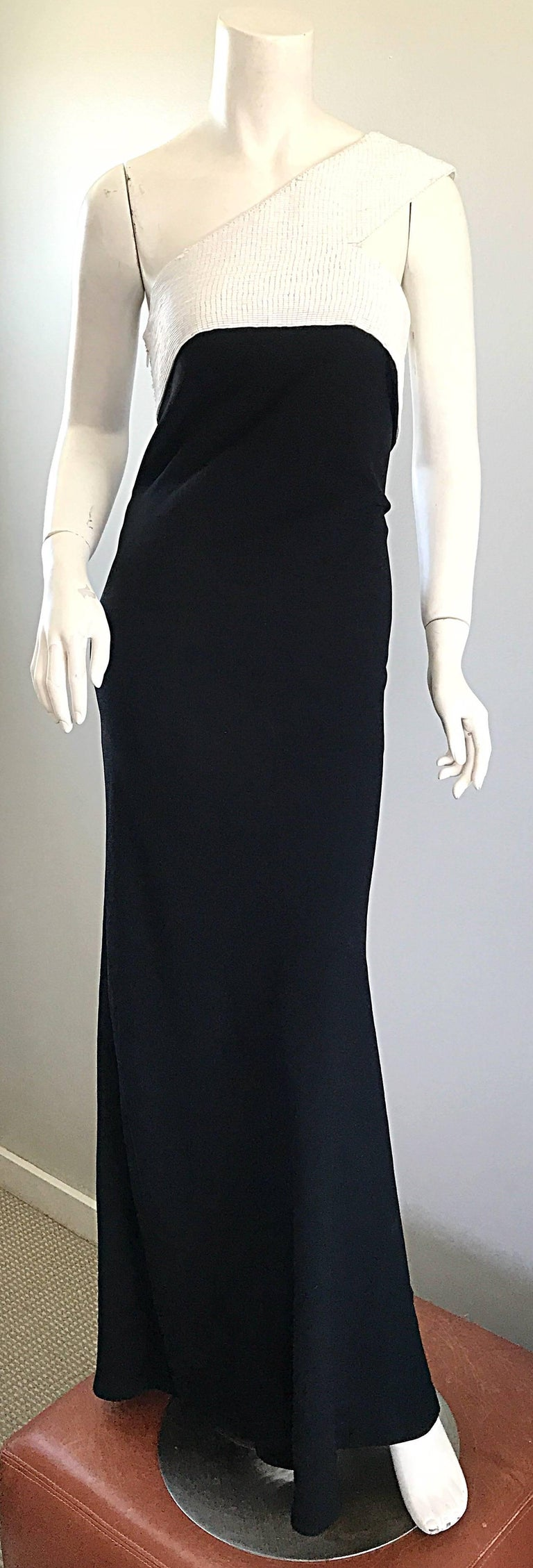 Red Carpet sophistication 1990s JACKIE ROGERS black and white one shoulder beaded color blocked silk evening dress! Features a flattering form fitting bodice with a tailored body, and slight flare at the hem. Hundreds of hand sewn beads encrusted on