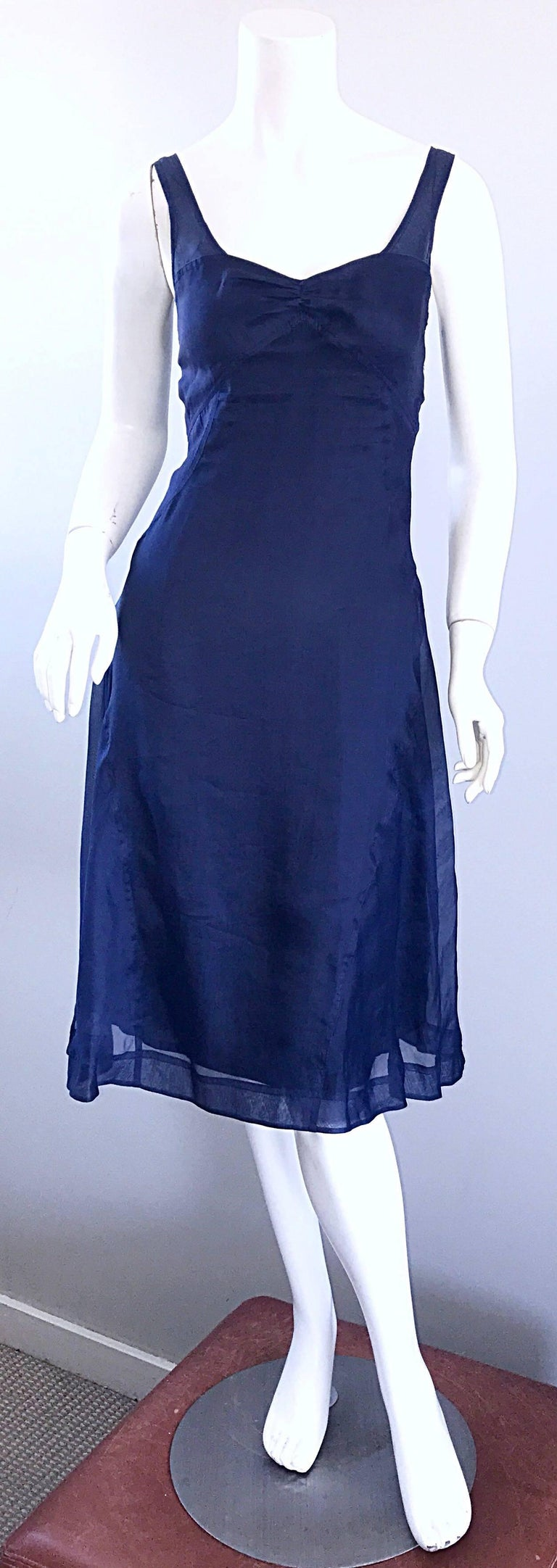 Chic late 90s CELINE navy blue silk chiffon sweetheart dress! Features a tailored bodice with a sweetheart neckline, which flows into a flirty flowy skirt. Skirt has a semi sheer navy chiffon overlay. Sits slightly off the shoulders. Hidden zipper