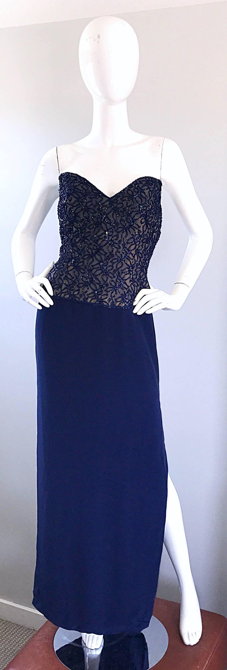 Stunning vintage BOB MACKIE navy blue strapless beaded and sequinened Grecian inspired evening dress! Features hundreds of beads sewn onto navy a navy mesh, with a boned nude underlay. Sexy slit reveals just the right amount of skin. Hidden zipper