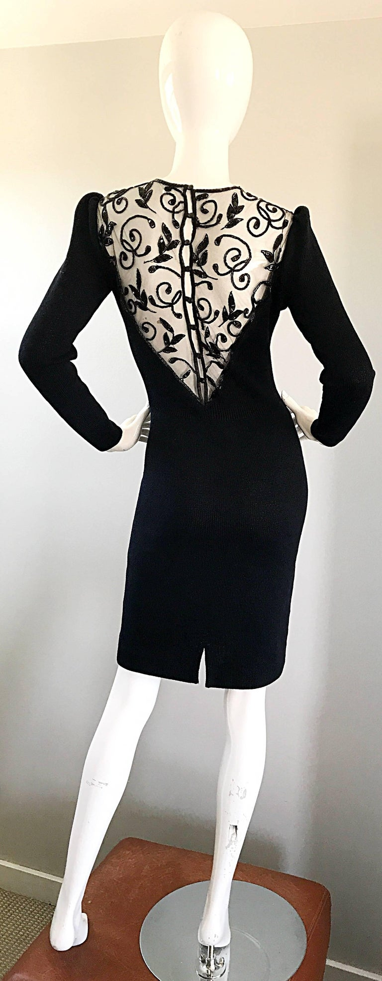 Beautiful 90s ST JOHN by MARIE GRAY Santana knit long sleeve sequined cut out back. Slight chic puff sleeves (no shoulder pads). Smart tailored cut that stretches to fit. Sequin encrusted mesh covers the cut-out back, and above the bust. Black