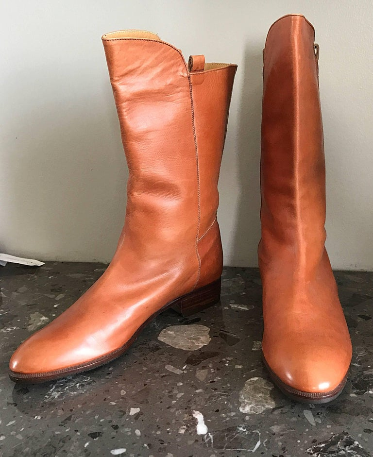 New never worn vintage 80s PERRY ELLIS tan cognac colored size 6 calf length leather boots! Saddle color literally matches everything! Simply slips on, and features leather soles. Adds a pop of color to a simple black outfit. Can easily be dressed