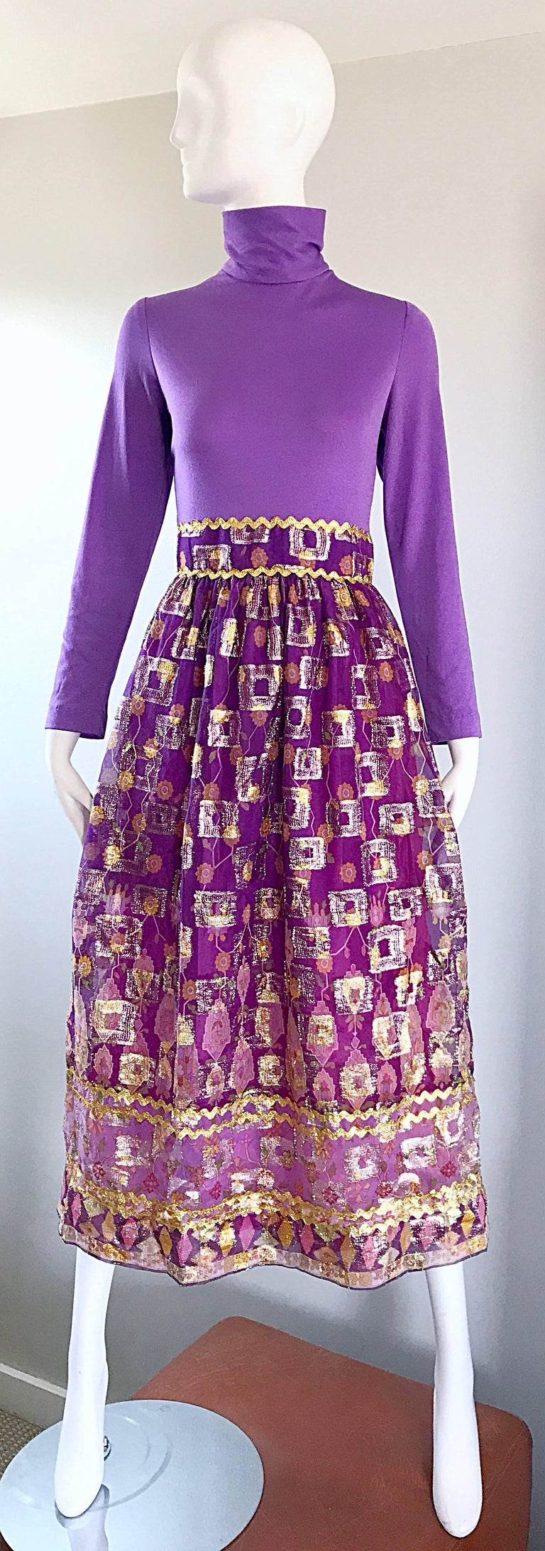 Gorgeous 70s ethnic batik print high neck purple / lilac long sleeve ombre midi dress / gown! Features a fitted soft stretch jersey bodice, with a full metallic semi sheer chiffon skirt (fully lined). Hidden zipper up th eback with hook-and-eye