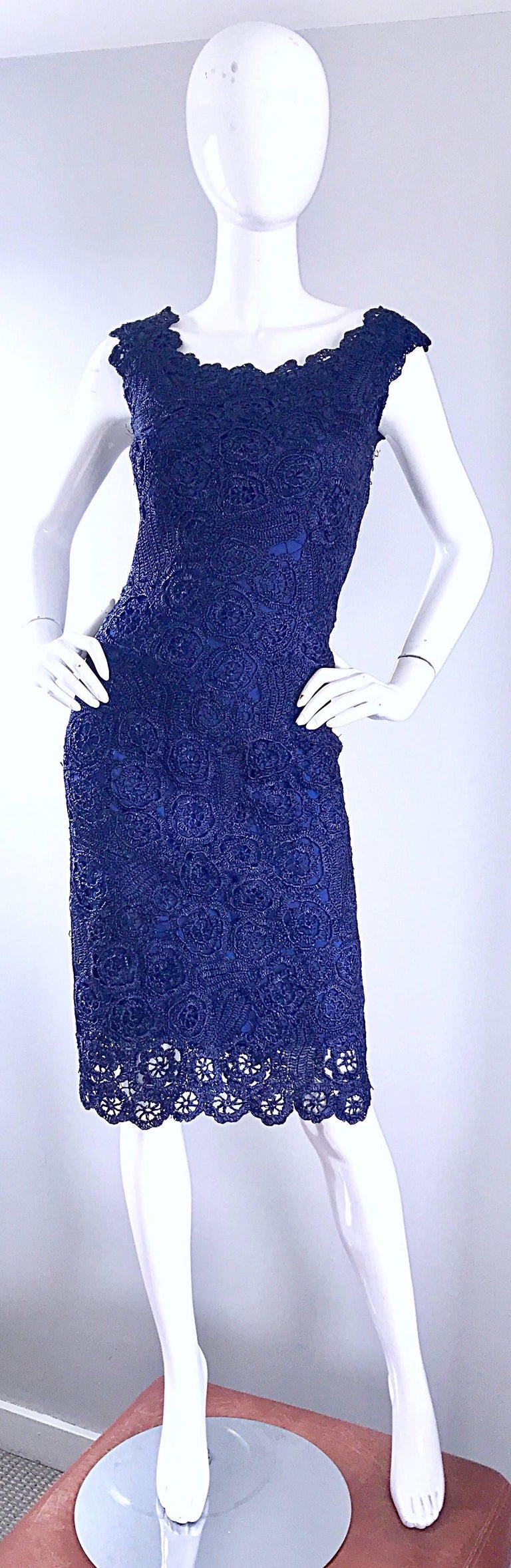Smashing 1950s Demi Couture navy blue raffia dress! Vibrant navy blue raffia with an attached silk lining. Full metal zipper up the side with hook-and-eye closure. Bombshell fit, with a fitted bodice and cap sleeves. Extremely flattering fit that