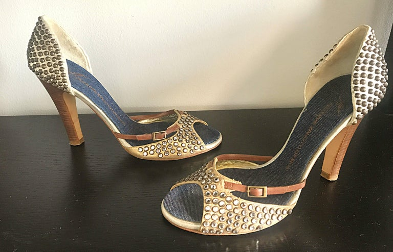 Gorgeous GIUSEPPE ZANOTTI bronze leather and brown rhinestone and stud encrusted high heel peep toe shoes! Features sparkly rhinestones on the front, and bronze round studs on the heel of the shoe. Inner sole is lined with soft dark denim. Stacked