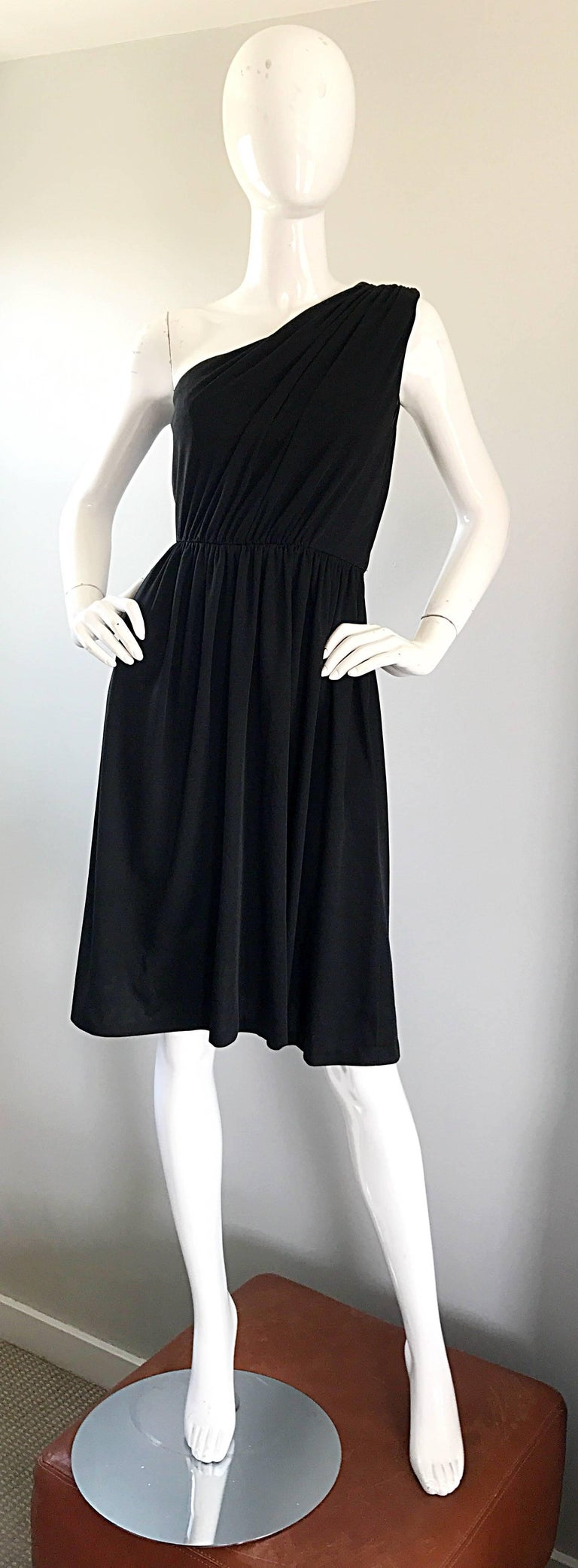 Amazing 1970s vintage ANTHONY MUTO for JOSPEH MAGNIN one shoulder black jersey dress! Beautifully draped bodice, with a free flowing knee length skirt. So much attention to detail went into the construction of this gem. Definitely has a Halston feel