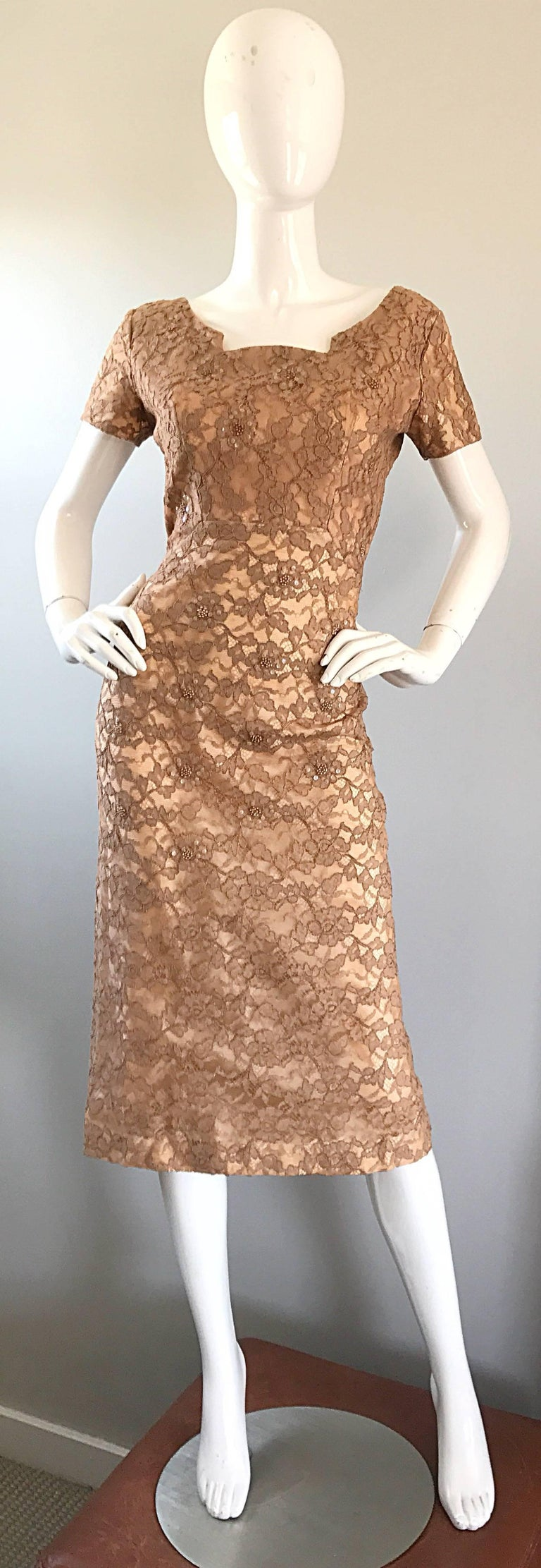 Gorgeous 1950s demi couture nude, tank and beige tea length silk lace cocktail dress! Impeccable construction, with so much heavy attention to detail. Fitted bodice features hundreds of hand-sewn iridescent sequins and beads throughout. Skirt