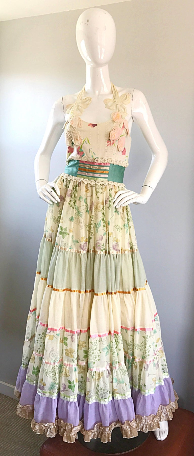 Gorgeous and rare early 1970s GIORGIO DI'SANT ANGELO boho halter maxi dress! Features colorful floral prints throughout. Layers and layer of soft cotton voile provide great movement. Fitted bodice with a full skirt. Embroidered flower and ribbon