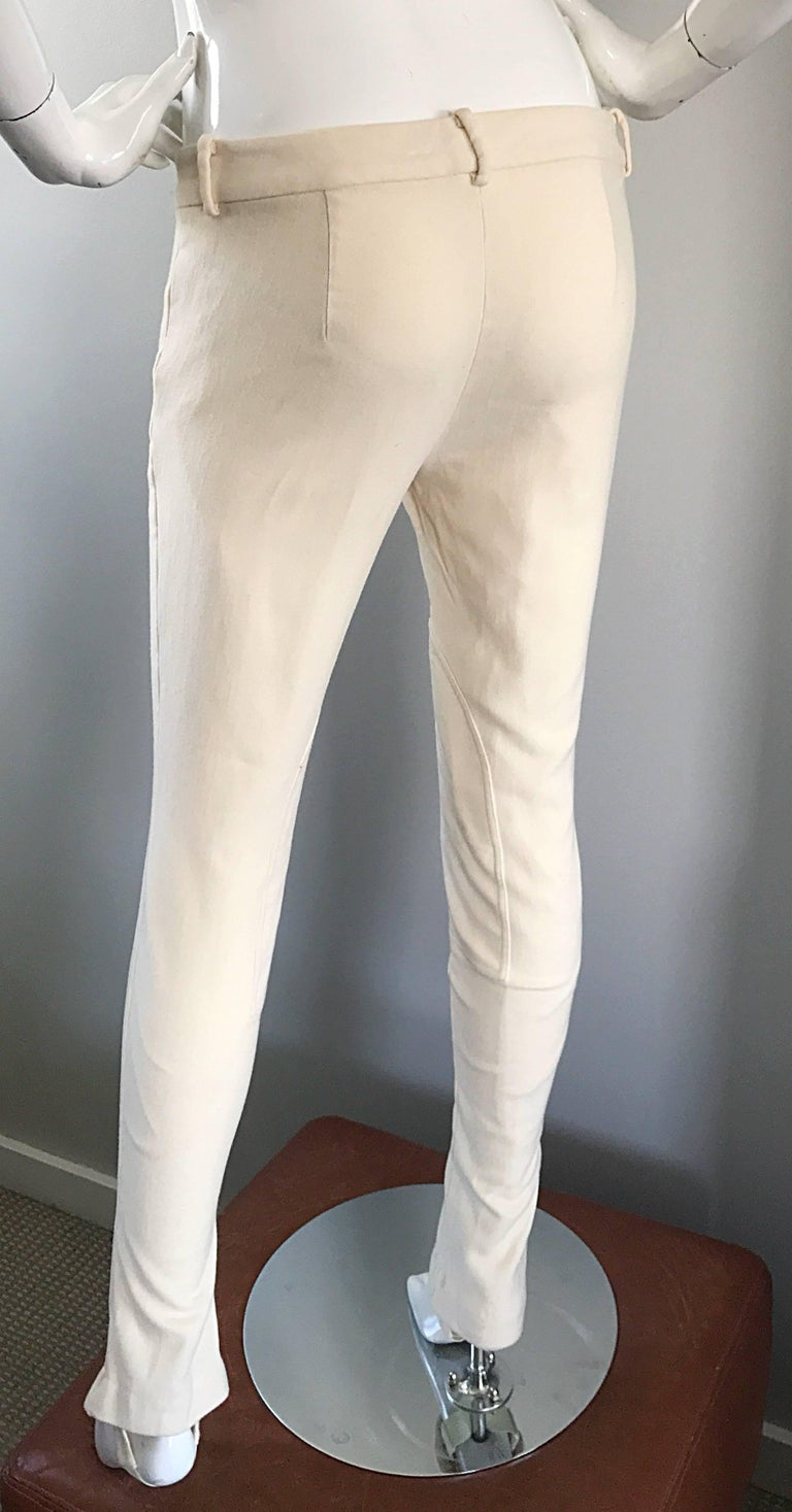 Classic Tapered Leg Stirrup Pants; Classic Tapered Leg Stirrup Pants. In Our Catalog: Stirrup Pant. Item # $ - $ The short-sleeved, black top has a lovely embroidered floral pattern at the neckline, while the comfy pants have a black and white floral print, side View Product [ x ] close.5/5.