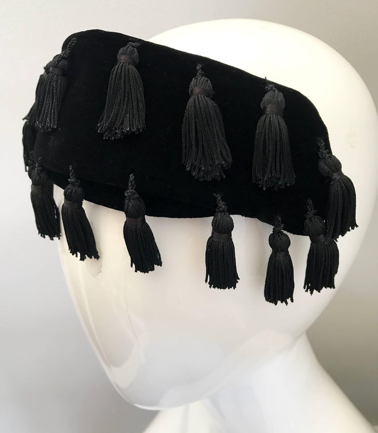 This 1950s NEIMAN MARCUS half hat fascinator is the perfect addition to an outfit! Black velvet, with about 20 tassels hand-sewn throughout. Can also be worn as a headband. Perfect with a dress, jeans, or a gown. Stretches to fit all head sizes. In