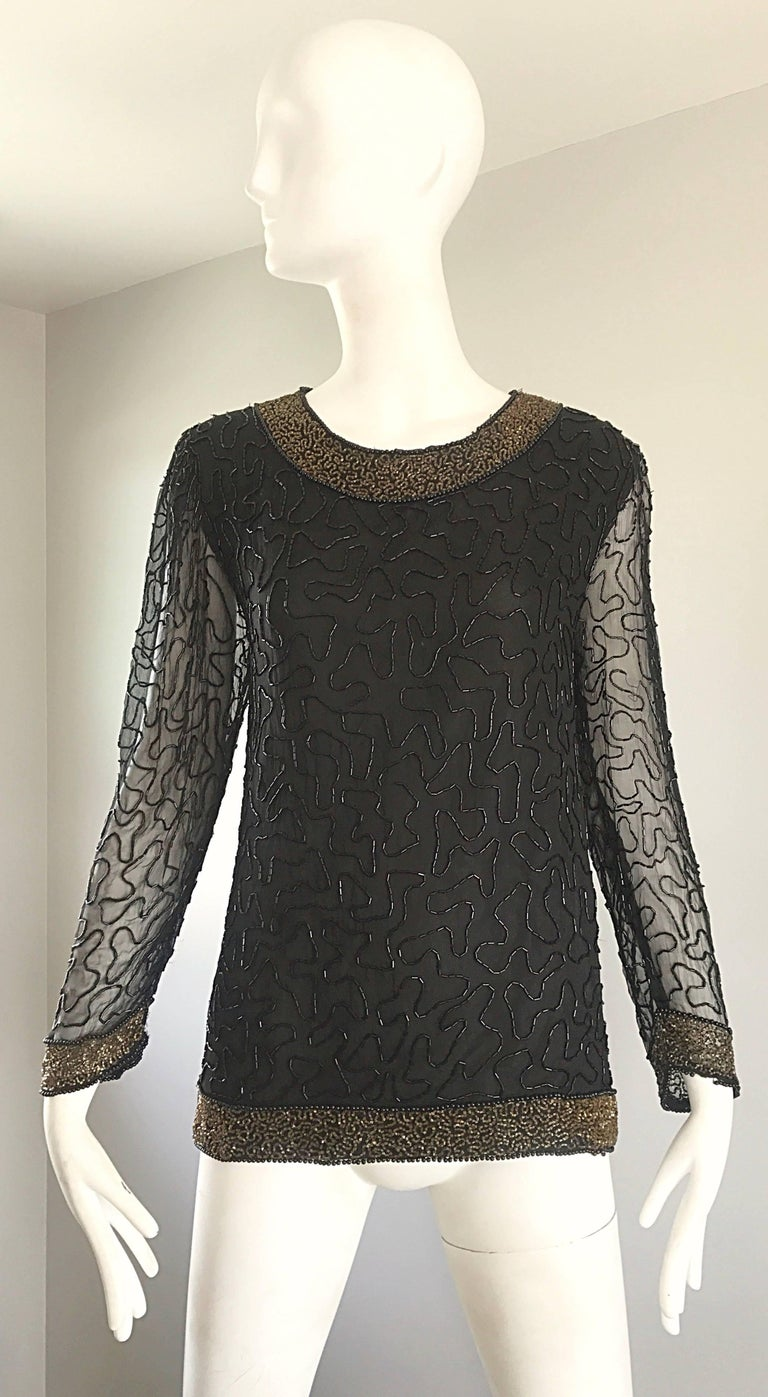 Stunning 1980s SWEE LO black and gold hand beaded silk chiffon long sleeve blouse! Wonderful tailored fit, with thousands of hand-sewn seed beads throughout. Neckline, sleeve cuffs, and waistband are all encrusted with goldseed beads. Semi sheer