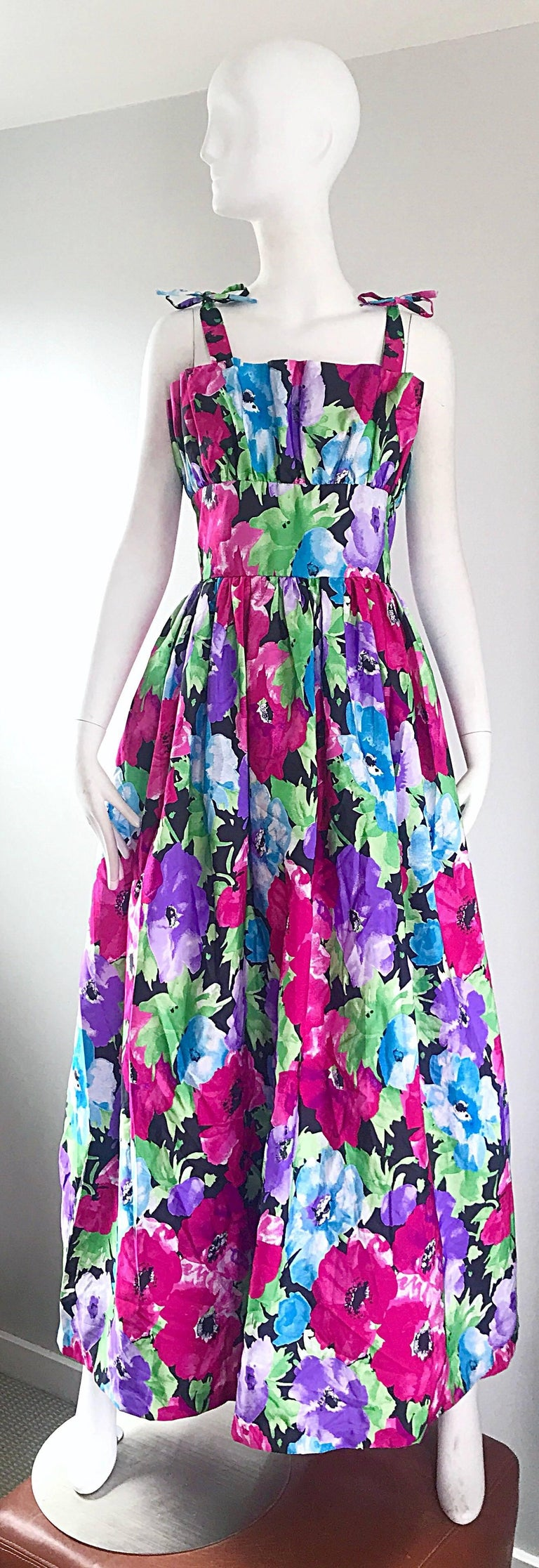 Gorgeous vintage VOCTOR COSTA taffeta flower gown / maxi dress! Features a tropical flower print in vibrant colors of pink, fuchsia, blue, green and black. Avant Garde accordion detail at the bodice. Detachable ribbon ties at each shoulder strap.