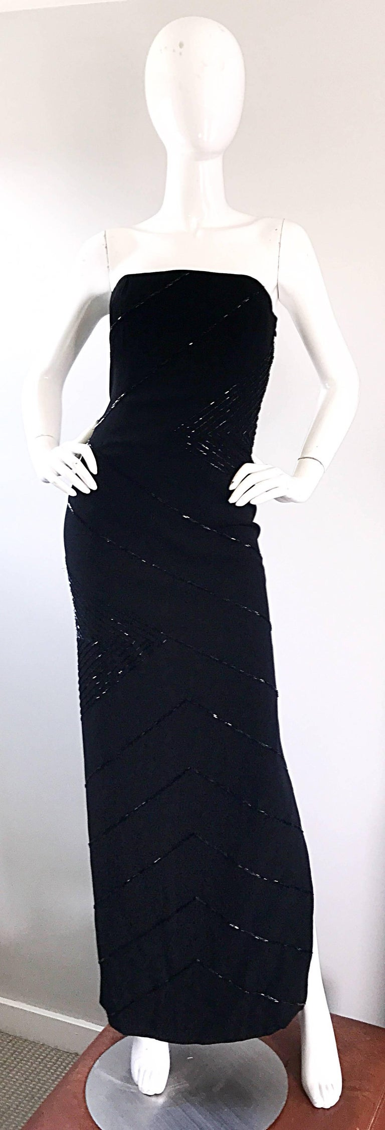 Stunning 1990s BILL BLASS black crepe beaded strapless evening gown! Features thousands of slimming black beads hand-sewn throughout. Interior boned bust helps keep everything in place, along with interior waist support. Hidden zipper up the side