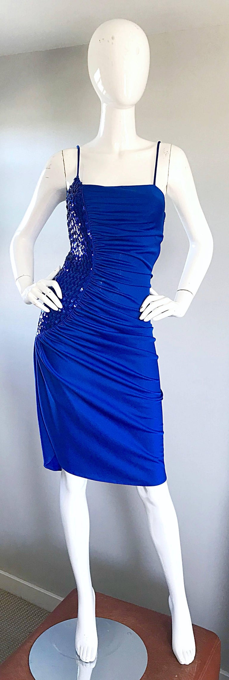 Sexy 1970s SAMIR royal blue jersey and sequined Studio 54 disco dress! Features a slinky jersey fabric with hundreds of hand-sewn sequins on the right side. Hidden zipper up the side. Stretches to fit. Insanely flattering, and a definite head