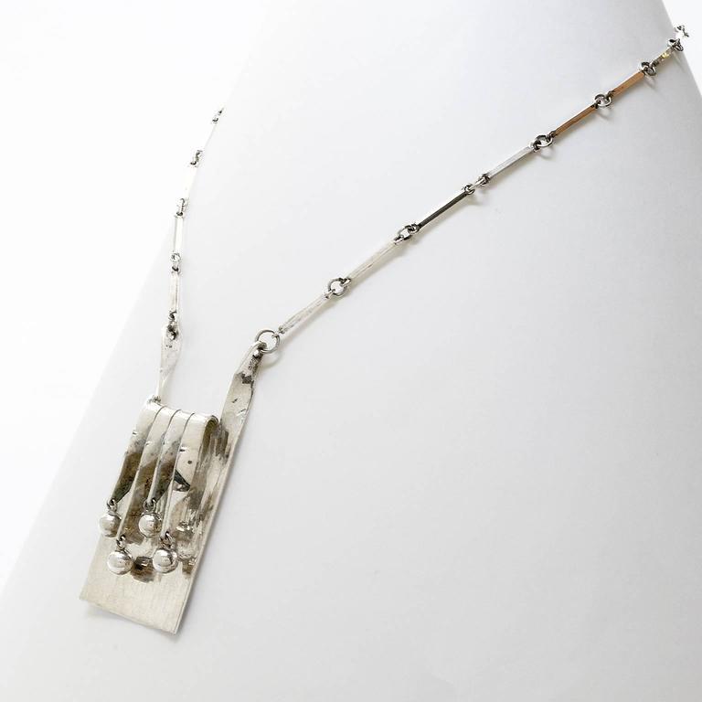 Women's Scandinavian Modern silver necklace and pendant by Eksjo Studio. For Sale