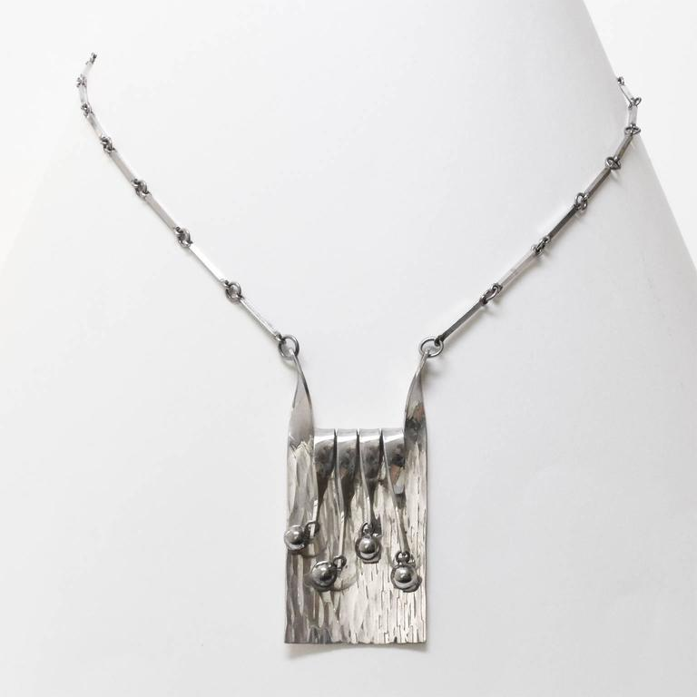Scandinavian modern silver necklace and chain with moving