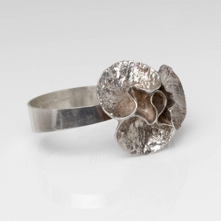 Silver bracelet with acid treated surface by Theresia Hvorslev and stamped 'Mema', Lidkoping, Sweden, 1976.