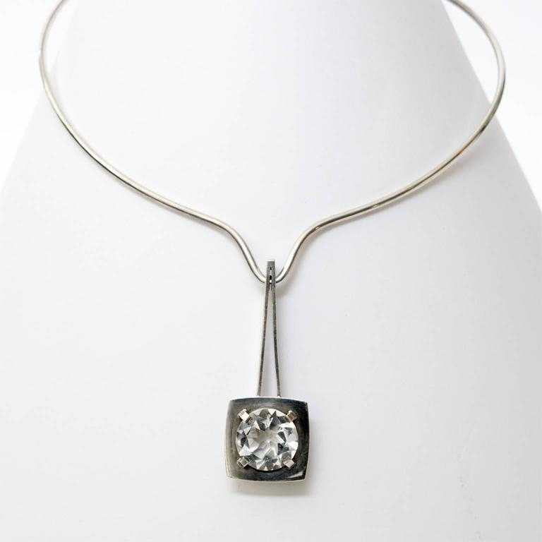 Silver necklace with a pendant holding a faceted rock crystal. Designed by Sven Haugaard, Denmark.