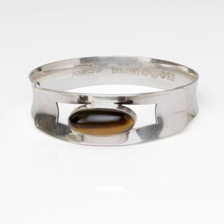 Scandinavian Modern silver bracelet with oval tigers eye stone. Signed, Pege, made by Alton, Sweden, 1966'