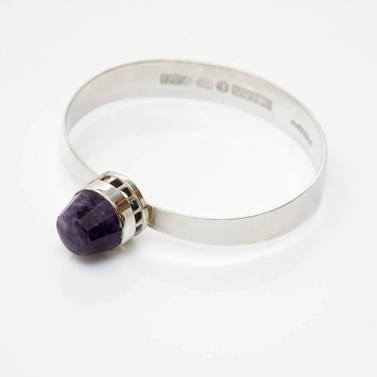 """Scandinavain Modern, Sterling silver bracelet with a faceted purple colored gemstone. Designed and stamped """"Pege"""" Alton, made in Sweden 1969."""