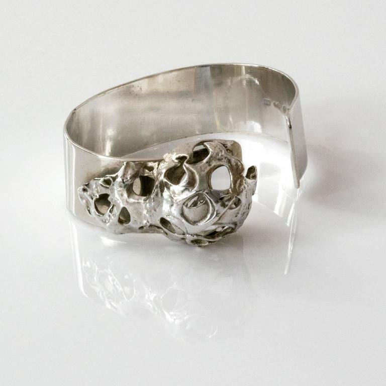 """A silver bracelet with a secret. A faceted rock crystal is caged inside an attached organic shaped structure. Designed by Peter Von Post, 1971, Stockholm Sweden. Diameter: 2.5"""" Height: 1"""""""