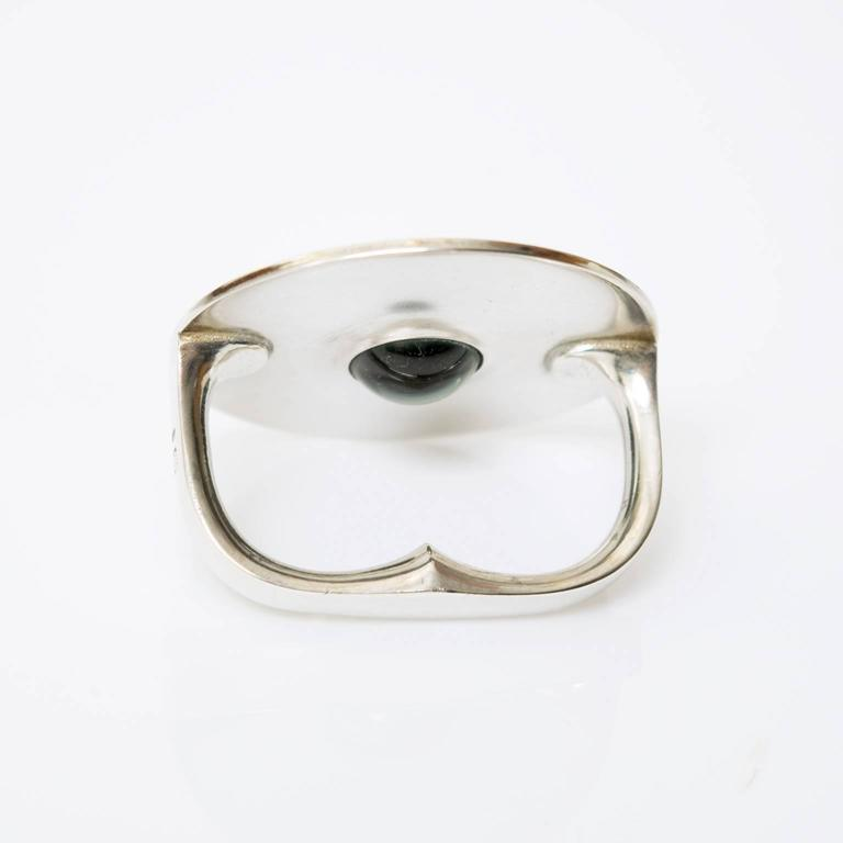 mod silver midcentury finger ring with green inset