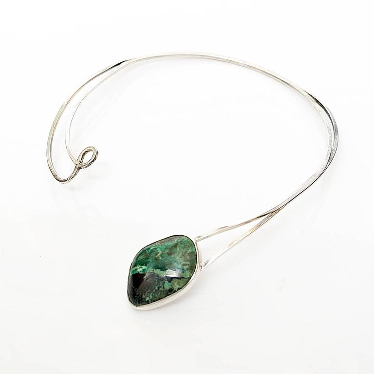 A Sterling Silver necklace detailed with a green stone cartouche. Designed by Issac Cohen, 1950's, Stockholm Sweden. Diameter: 5.5