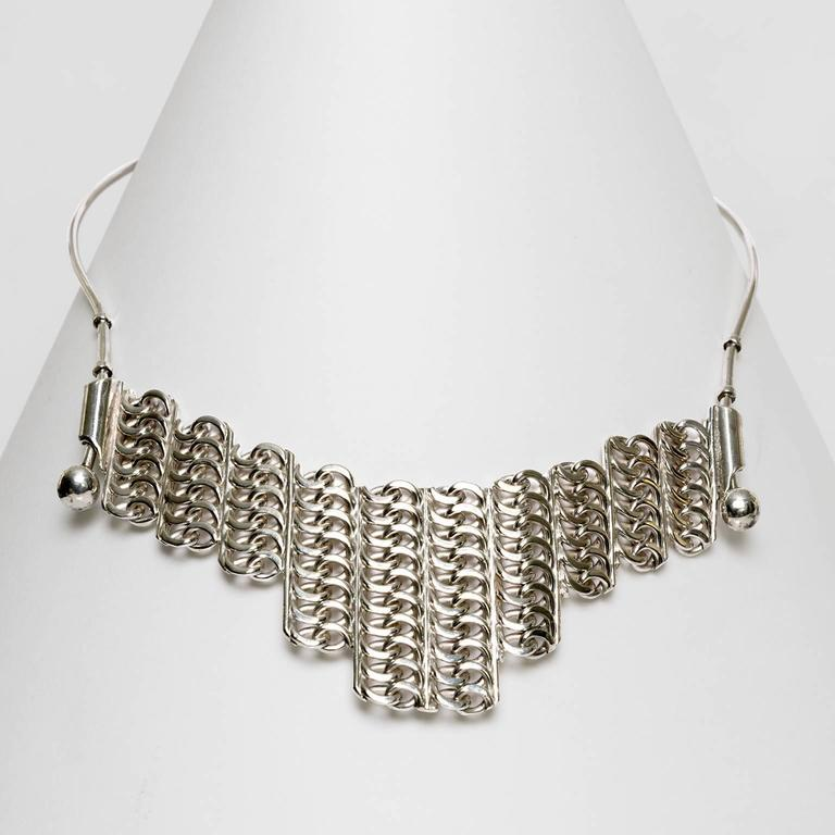 A Scandinavian modern sterling silver necklace with adjustable panel. Made by S.G. Hellstrom, Gnesta, Sweden, 1965   Opening diameter: 5