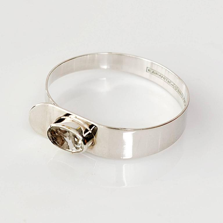 Scandinavian Modern Sterling silver bracelet with a faceted rock crystal. Made by Erik Granit, Helsinki, Finland 1971. Diameter: 2 Height: 2.25`