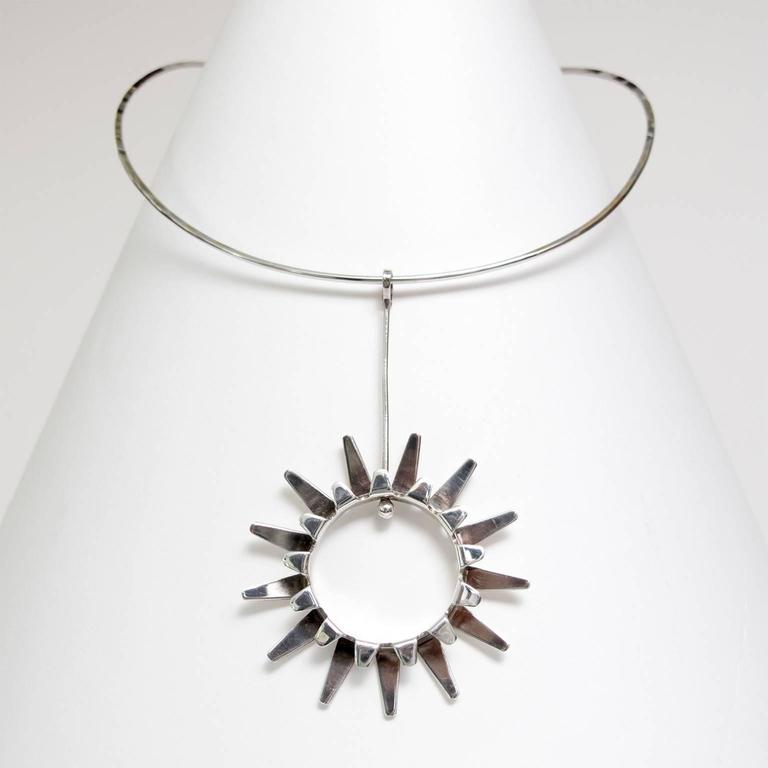 Scandinavian Modern Sterling silver necklace and sun pendant designed by Tone Vigeland for Designs Plus Studios, Norway circa 1970. Width: 5.5