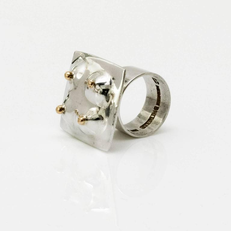 Scandinavian Modern Surrealist inspired silver ring details in gold on a soft organic form. Designed by Ove Bohlin, 1971, Stockholm, Sweden.