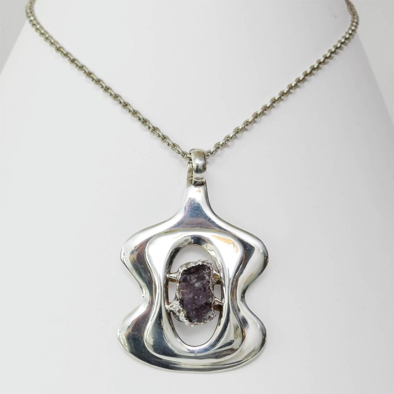 """Silver plated metal with amethyst stone pendant of sterling silver chain. Designed by Jacob Hull for B&D, Denmark circa 1960-1970. Chain length: 9.5"""" Pendant height: 3.5"""""""