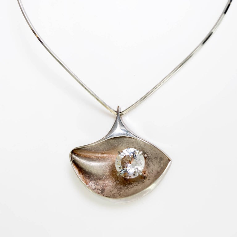 Scandinavian Modern sterling necklace and pendant with mounted rock crystal. Designed by Matti J Hyvärinen for Sirokoru, Finland, circa 1950's.