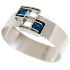 Scandinavian Modern Lögeskov Tenn, polished pewter bracelet with blue glass.