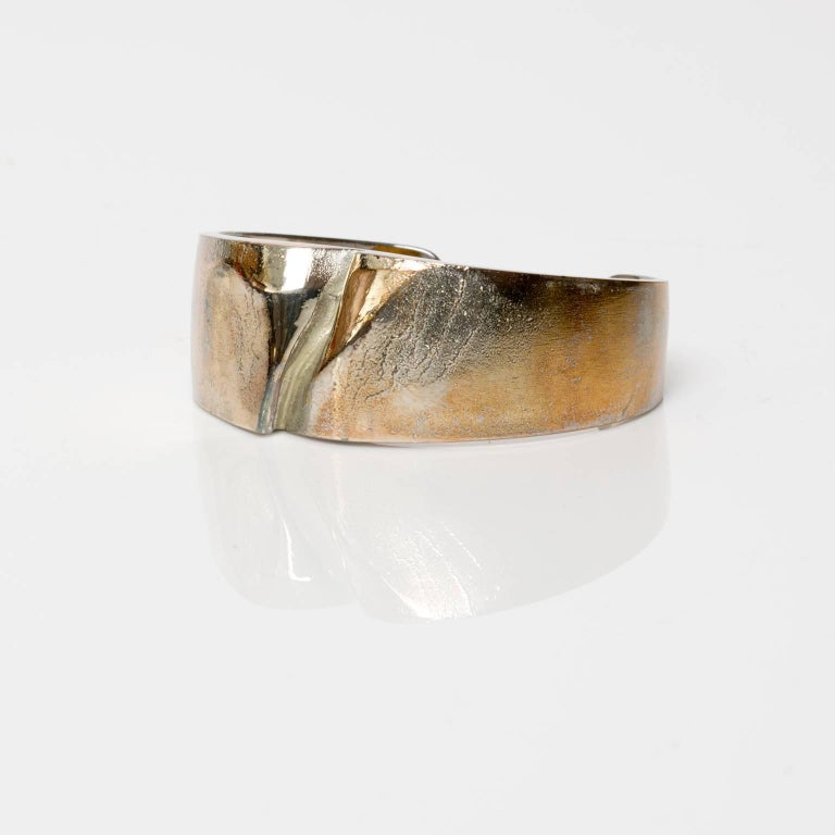 A Finnish silver bracelet in silver by Bjorn Weckstrom for Lapponia, 1971. Weckstrom's work is famous for his unique patination  treatments and surface textures.   Width: 2.5