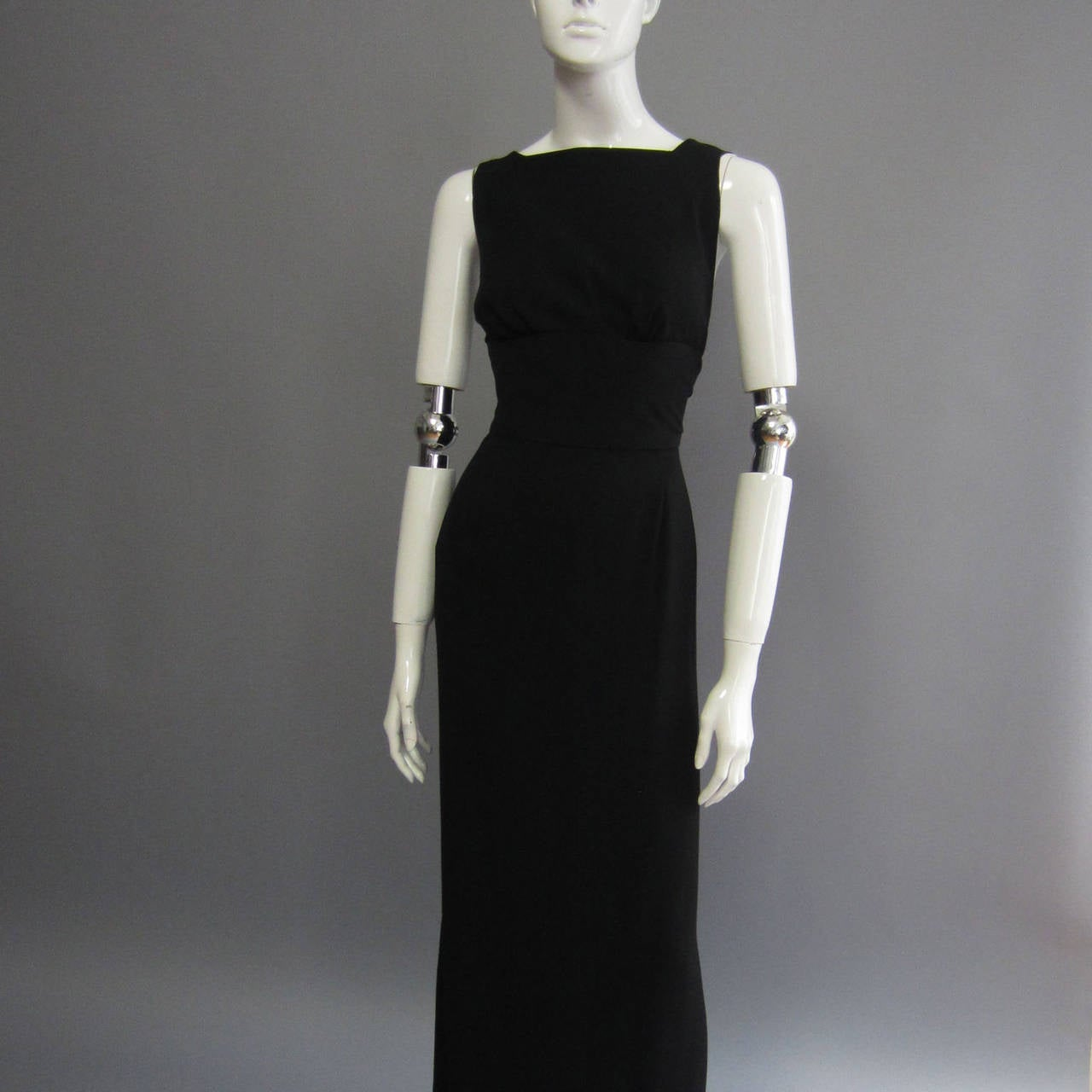 The epitome of chic, this NORMAN NORELL dress is reminiscent of the classic fashion icon Hudrey Hepburn. Its simplicity yet striking beauty makes it a timeless piece of fashion history. The black silk crepe creates a wide band at the front waist.